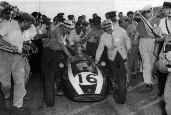 John Cooper and Charles Cooper pushing home Bruce McLaren