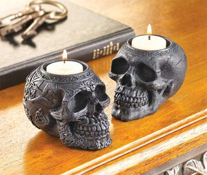 Two ornate skull candle holders