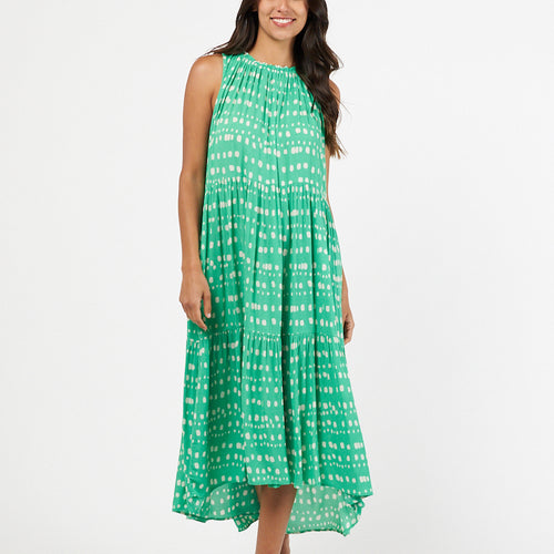 Sleeveless midi dress with elasticised crew neckline and high low hem in vivid green and white spot print. Rayon fabric with a loose flowing fit.