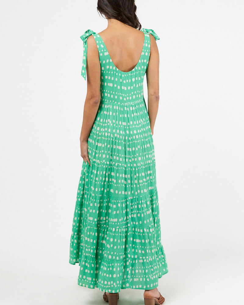 Vivid green with white spots printed rayon dress with shoulder ties and maxi length.