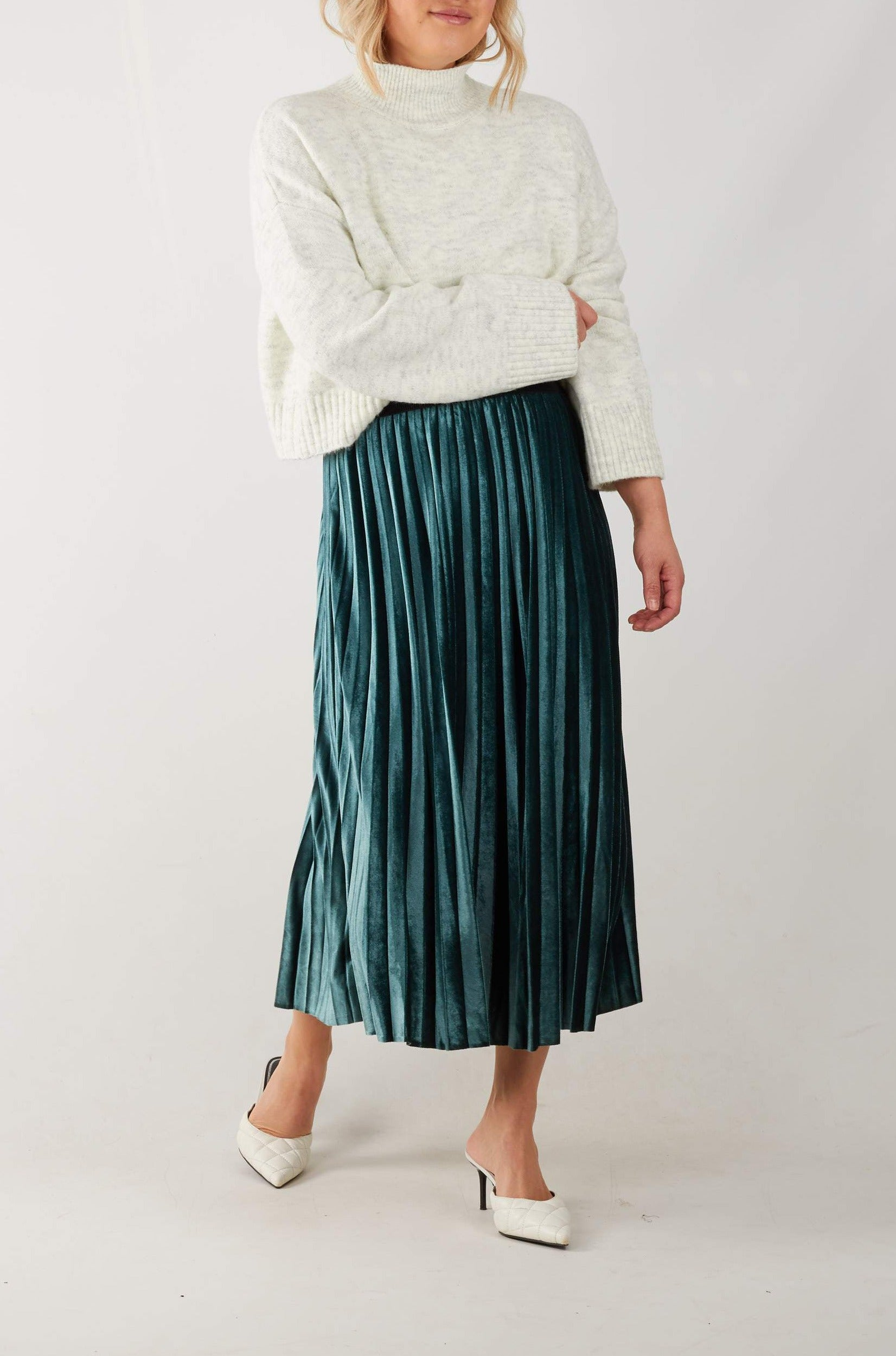 Deep green velvet pleated midi skirt with contrast black elasticised waistband. Also available in dusty pink.