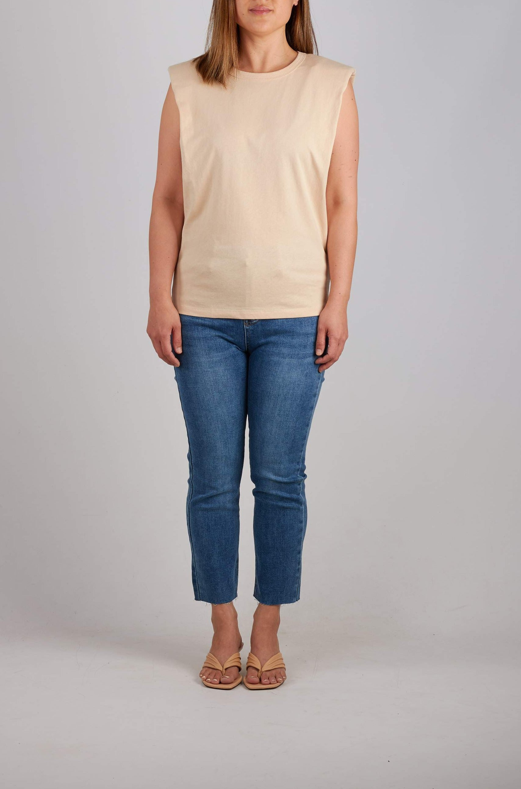 Padded shoulder sleeveless t-shirt in beige. Also available in White & Black.