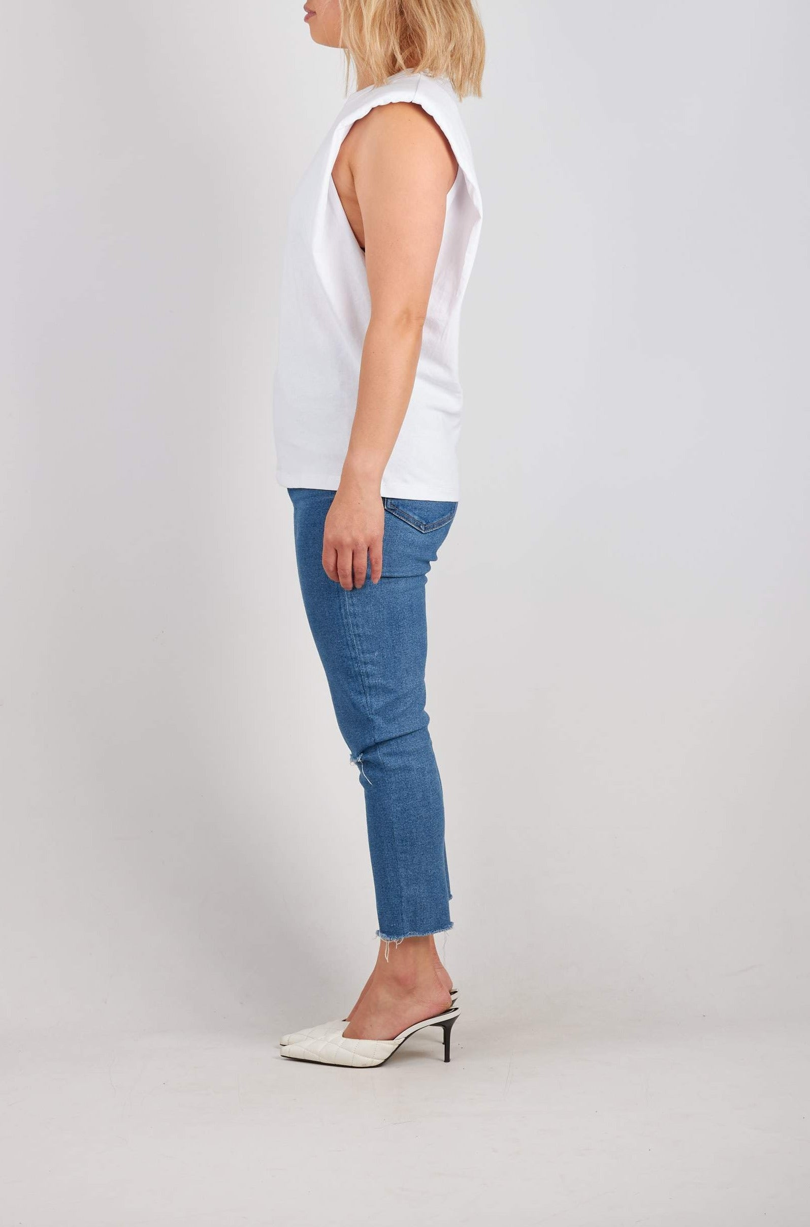 Padded shoulder sleeveless t-shirt in beige. Also available in Beige & Black.