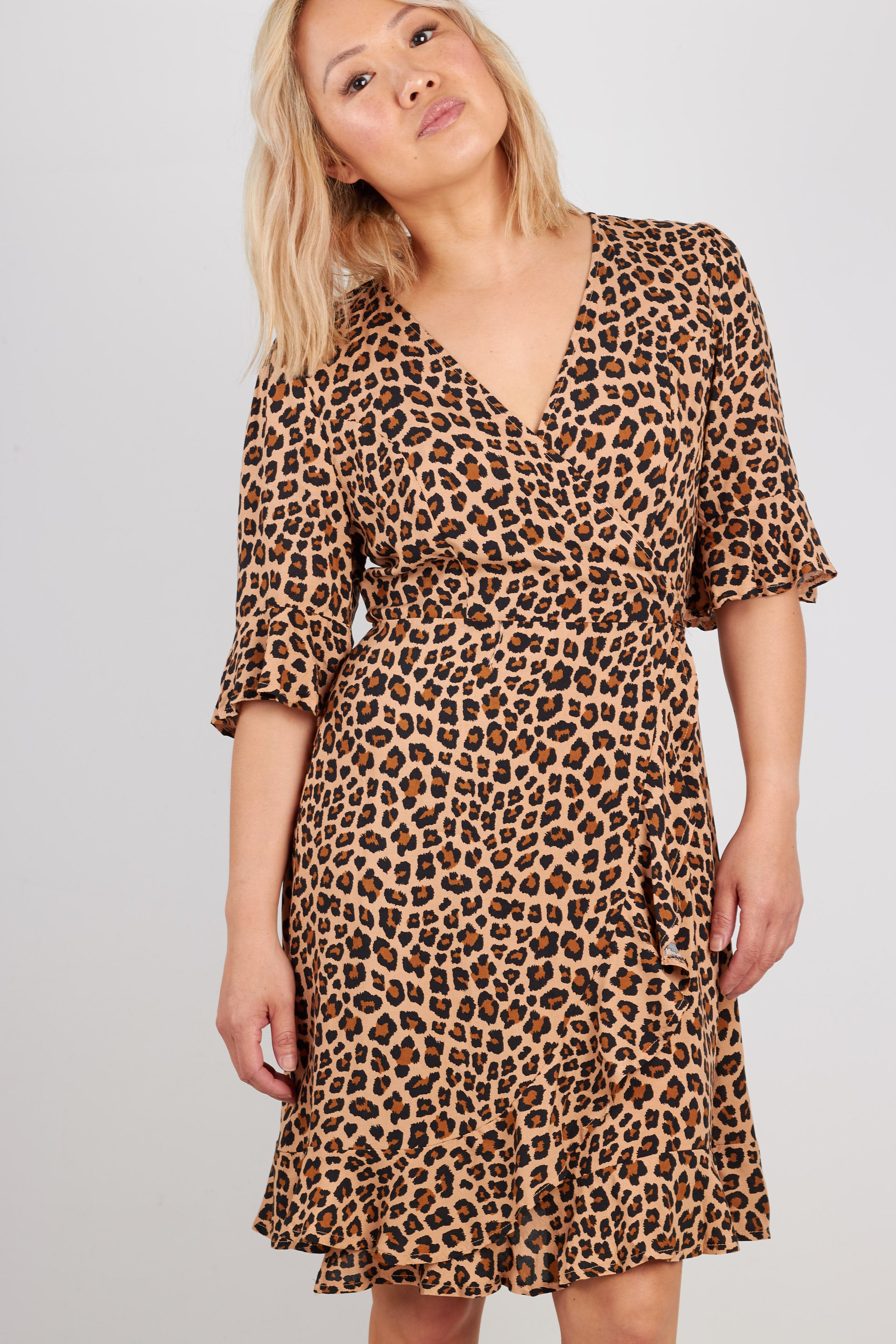 Leopard print mini wrap dress with frill hem and short sleeves.