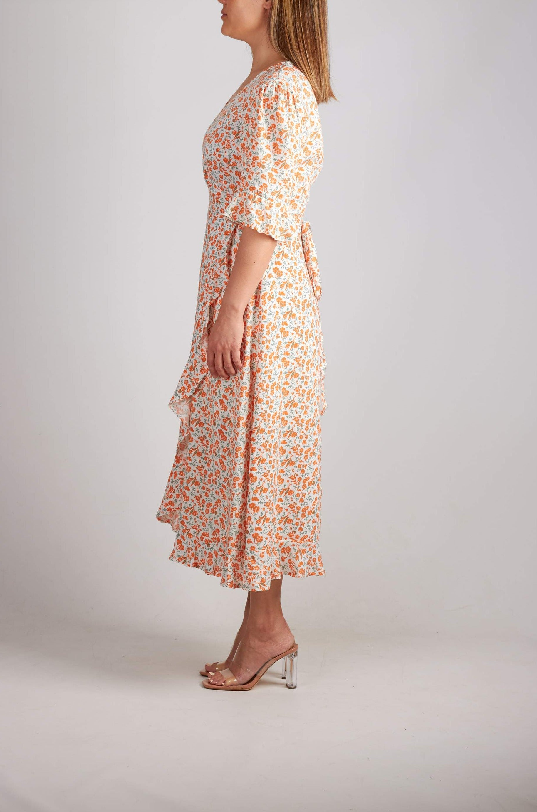 White and orange ditzy floral wrap midi dress with frill hem and sleeves.
