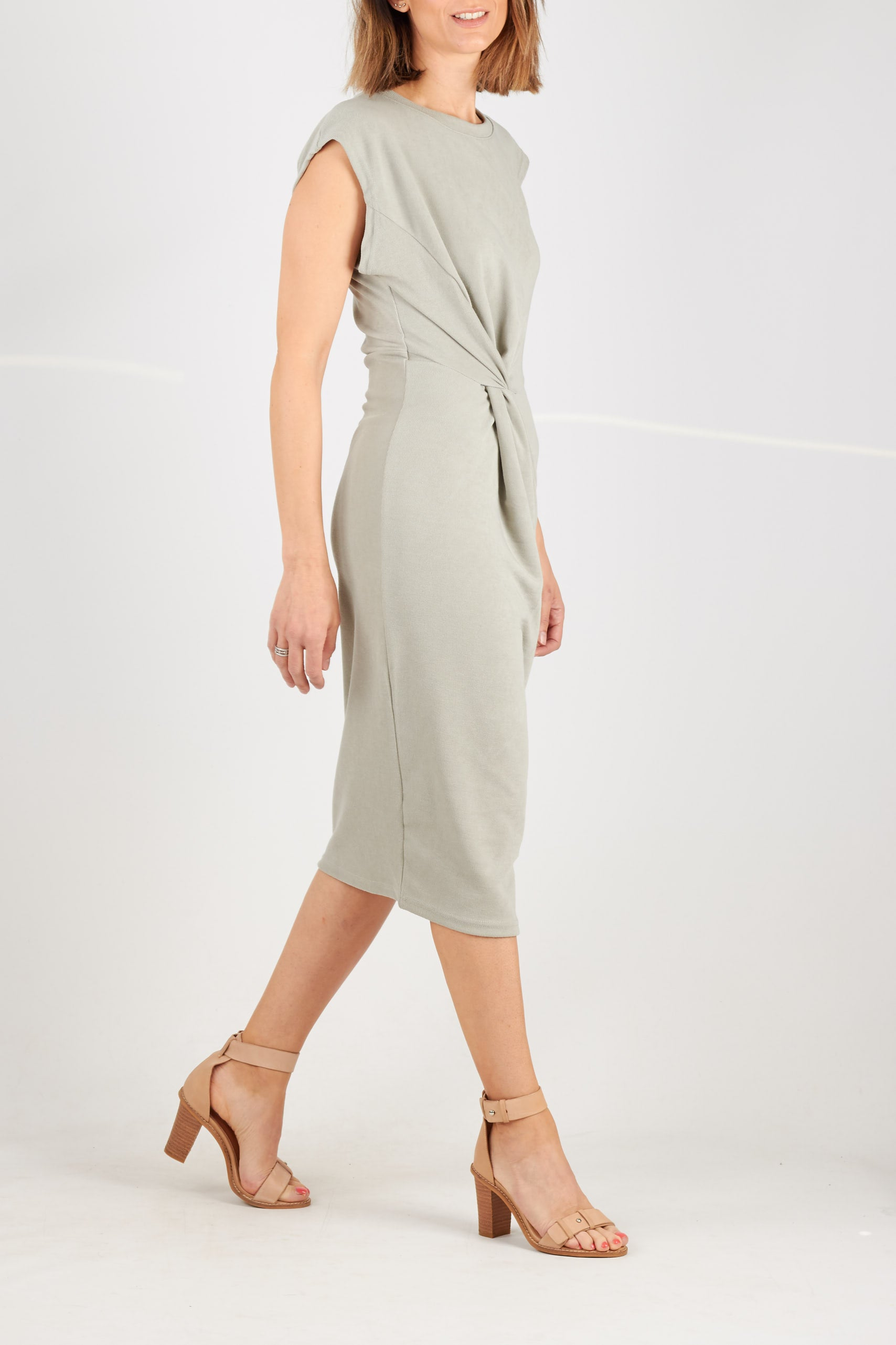 Sage green ribbed knit cap sleeve midi dress with twist feature at waist.