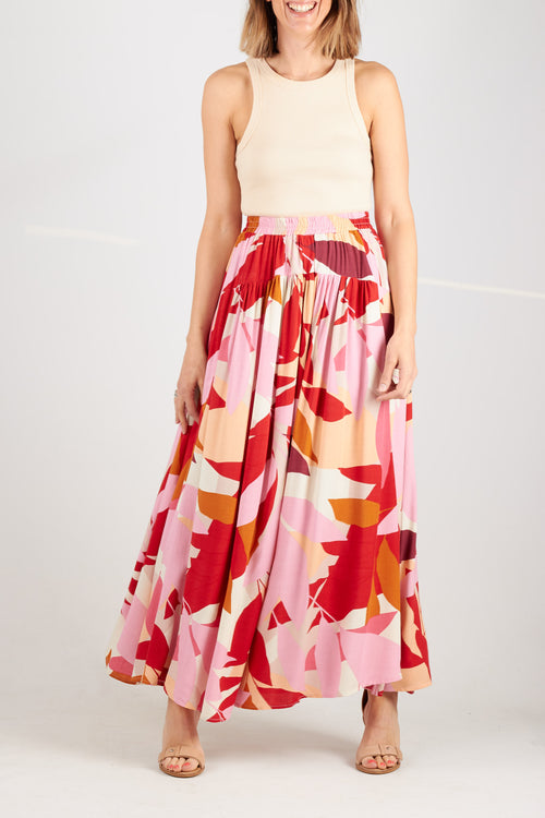 Pink, orange and coral printed maxi skirt with elasticised waistband and side pockets. Pull on design.