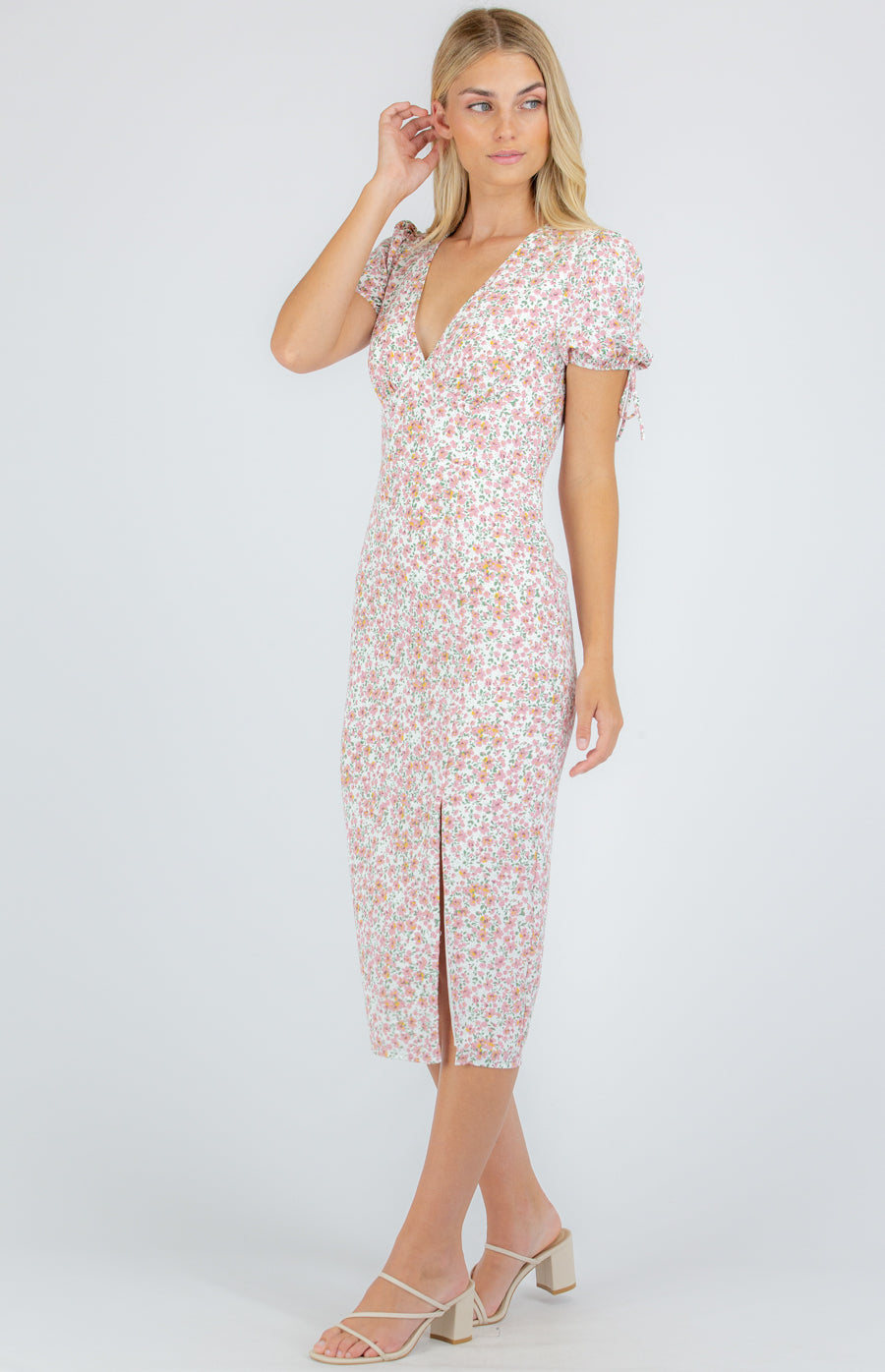Pretty midi dress in pale pink rose print with short puff sleeves, v neck and front leg split.