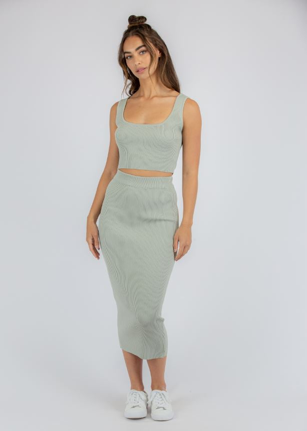 Top and skirt set in sage colour ribbed knit fabric. Cropped sleeveless square neck singlet top with midi pencil skirt.