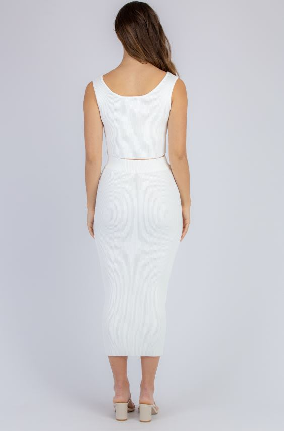 Top and skirt set in WHITE colour ribbed knit fabric. Cropped sleeveless square neck singlet top with midi pencil skirt. Also available in SAGE.