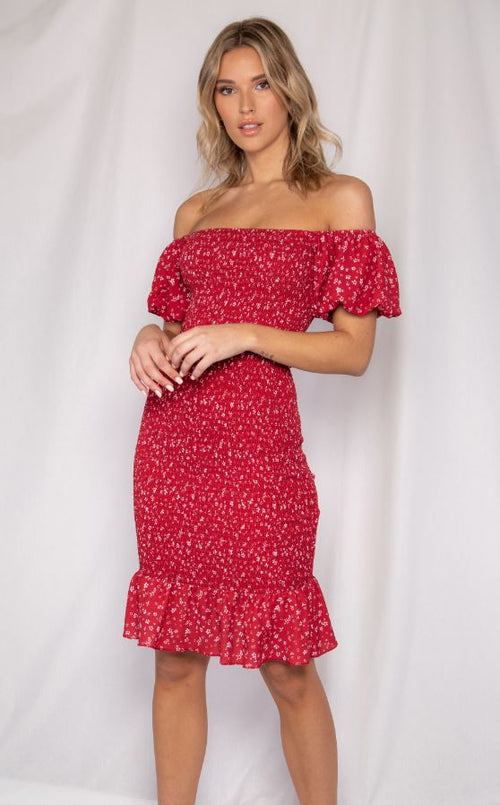 Elasticised off the shoulder shirred midi dress with puff short sleeves and frill hem in a feminine red floral print. also available in red print.