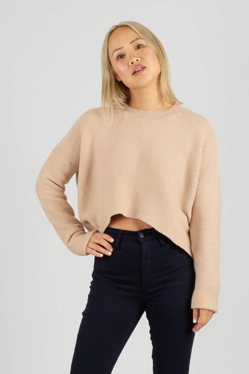 Beige ribbed knit jumper with crew neck and cropped length