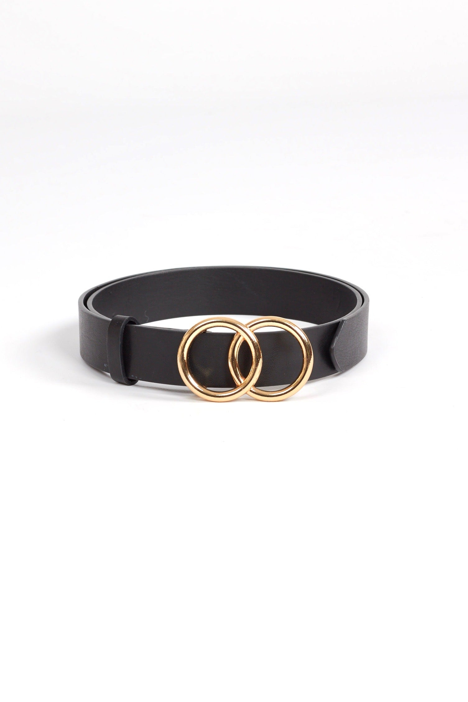 Black vegan leather belt with gold toned metal double circle belt buckle. Free shipping on domestic orders over $75. Afterpay available. We ship worldwide!