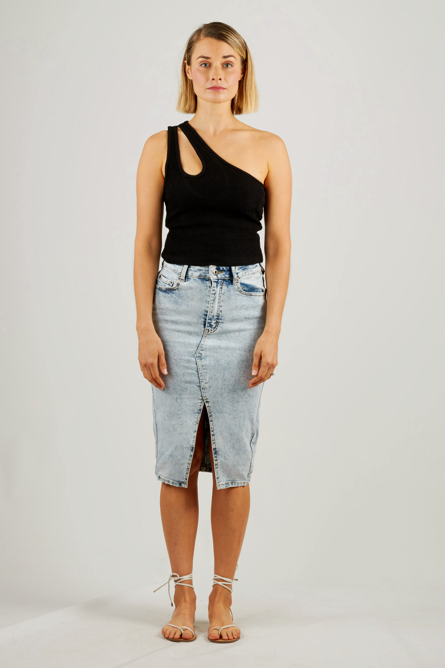 Black asymmetrical top with cut out detail on shoulders