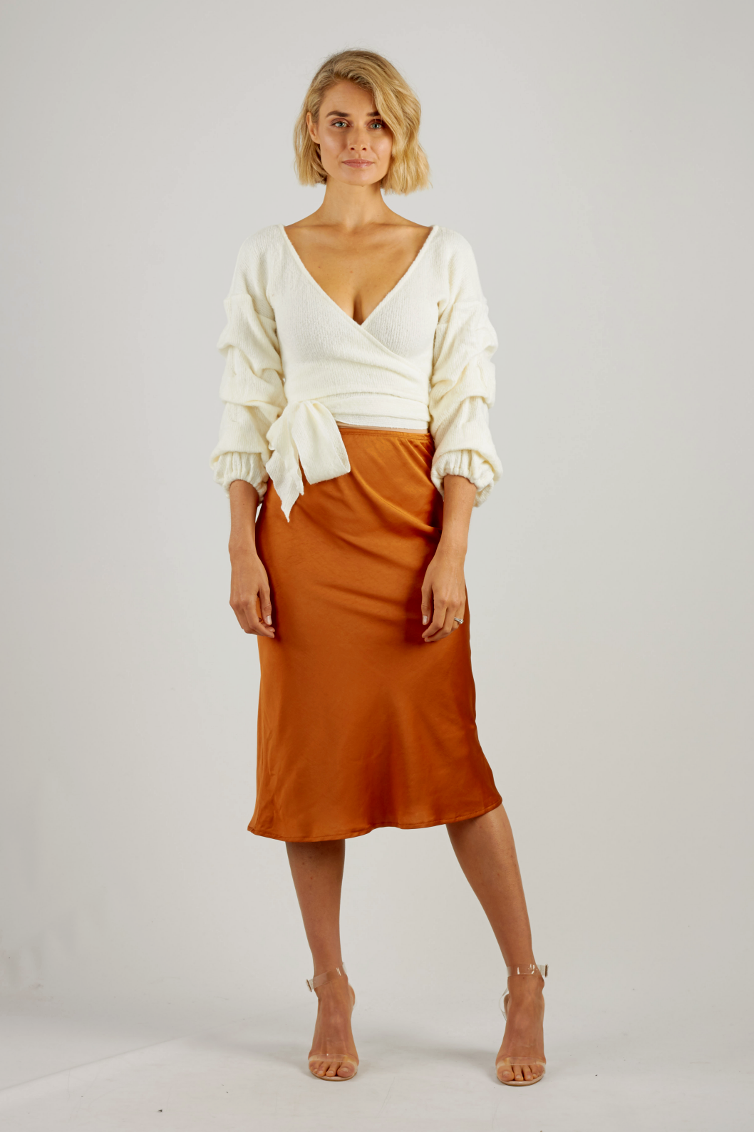 Cream knit wrap cropped top with balloon sleeves