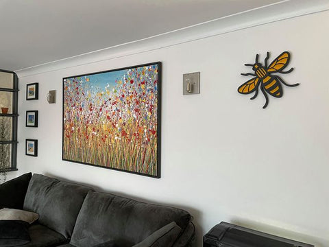 Customer photo showing my abstract original flower meadow painting on display in her home 1