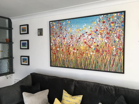 Customer photo of a painting by Rich Gane showing the painting on display in her home 1
