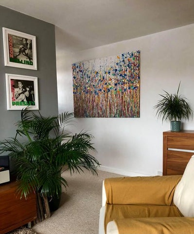 Customer photo showing my oversize abstract blue flower drip painting on display in her home