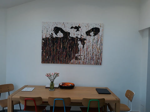 Customer photo showing my large cow portrait painting on display in her home