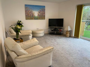 Customer showcase photo of my original purple flower meadow painting on display in her home