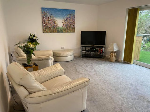 Customer showcase photo of my original purple flower meadow painting on display in her home 2