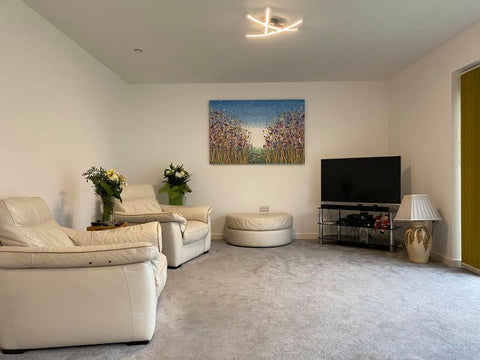 Customer showcase photo of my original purple flower meadow painting on display in her home 3