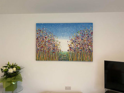 Customer showcase photo of my original purple flower meadow painting on display in her home 1