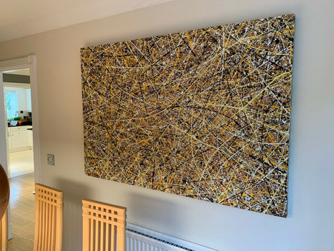Customer photo of my very large original gold drip painting on display in his home