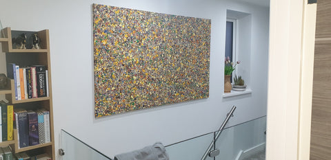 Customer photo showing my large brown and yellow spot painting on display in his home