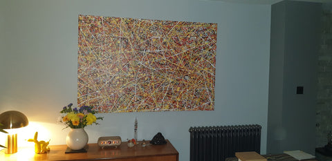 Customer photo showing my large colourful drip painting on display in his home