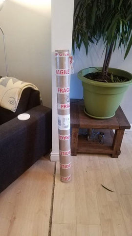 Customer photo showing my cardboard postage tube shortly after he had received the painting