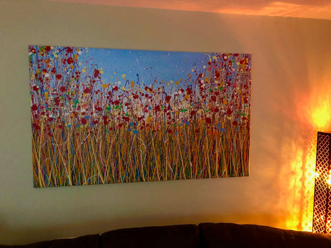Customer photo showing my large abstract red poppy flower painting on display in his home 1