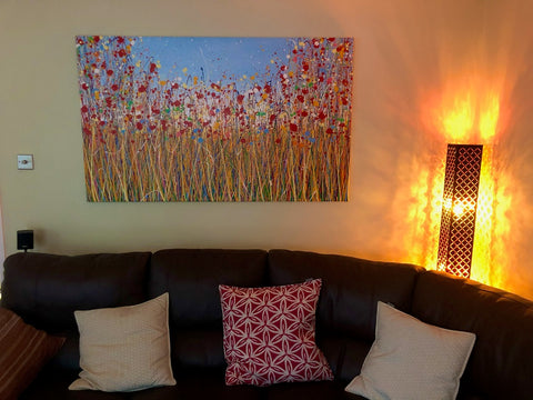 Customer photo showing my large abstract red poppy flower painting on display in his home 2