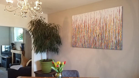 Customer showcase photo of my original large drip painting in custom colours now on display in his home 1