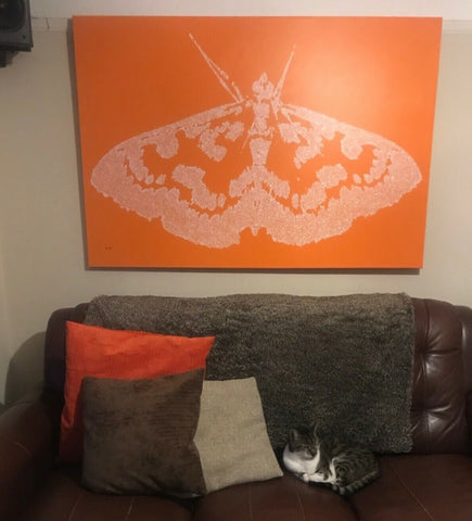 Customer showcase photo of my white and orange dot and spot moth painting on a very large canvas