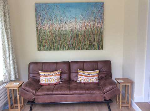 Green grass meadow painting hanging in my customers house