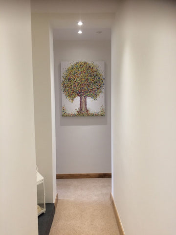 Large green tree painting in customers house