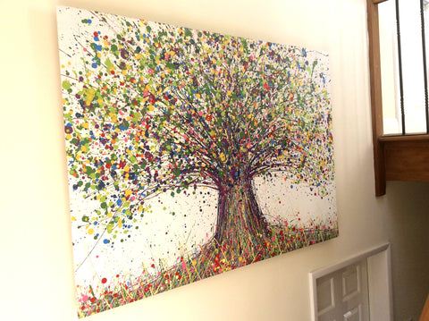 Original green tree painting hanging in customers house