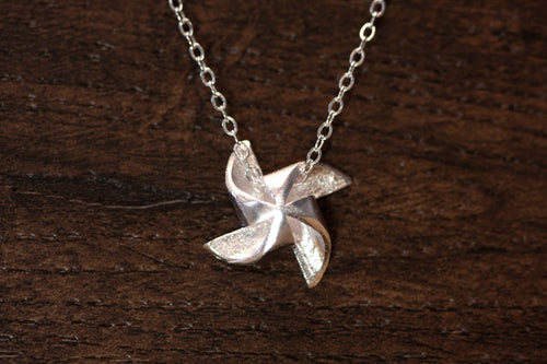 Newborn Feathers Sterling Silver Pinwheel Necklace