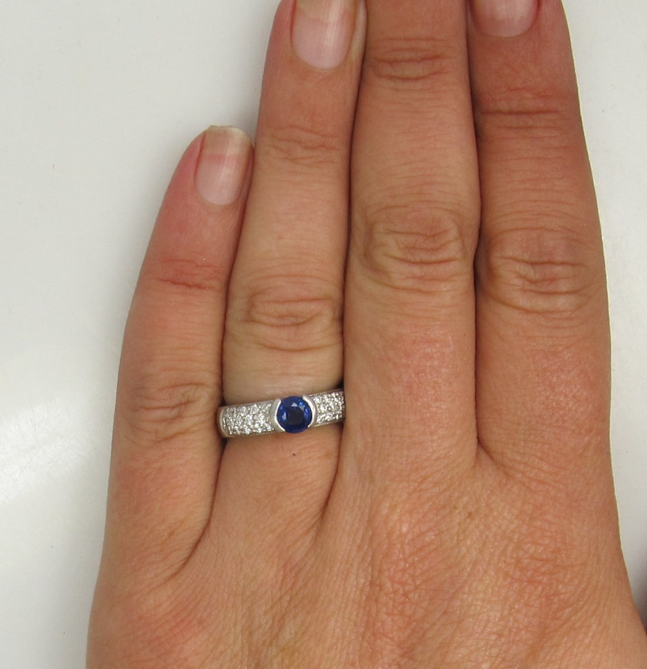 Platinum Ring With A .50ct Sapphire And .50cts Tw In Diamonds.