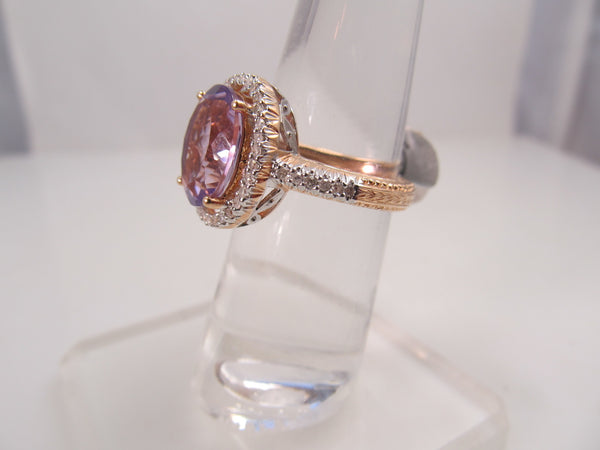 14k rose gold ring with amethyst and .50cts in diamonds
