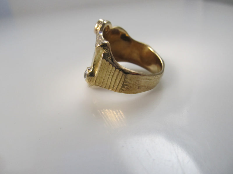 Art Nouveau lion signet ring with diamonds
