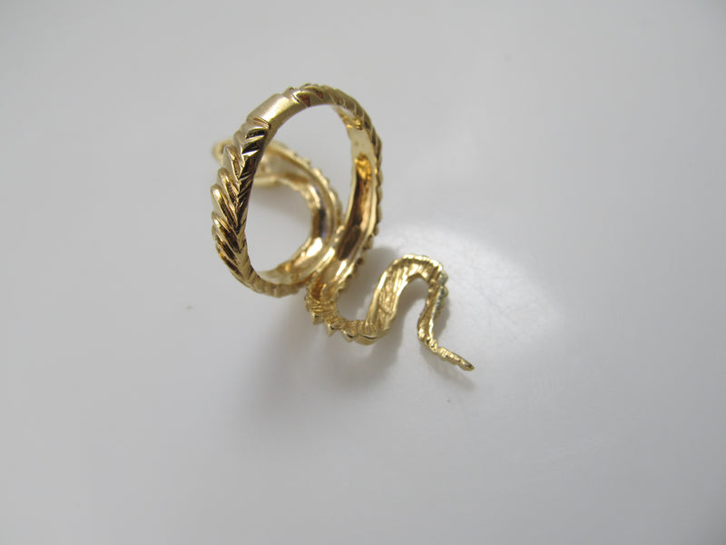 Long vintage snake ring with ruby eyes