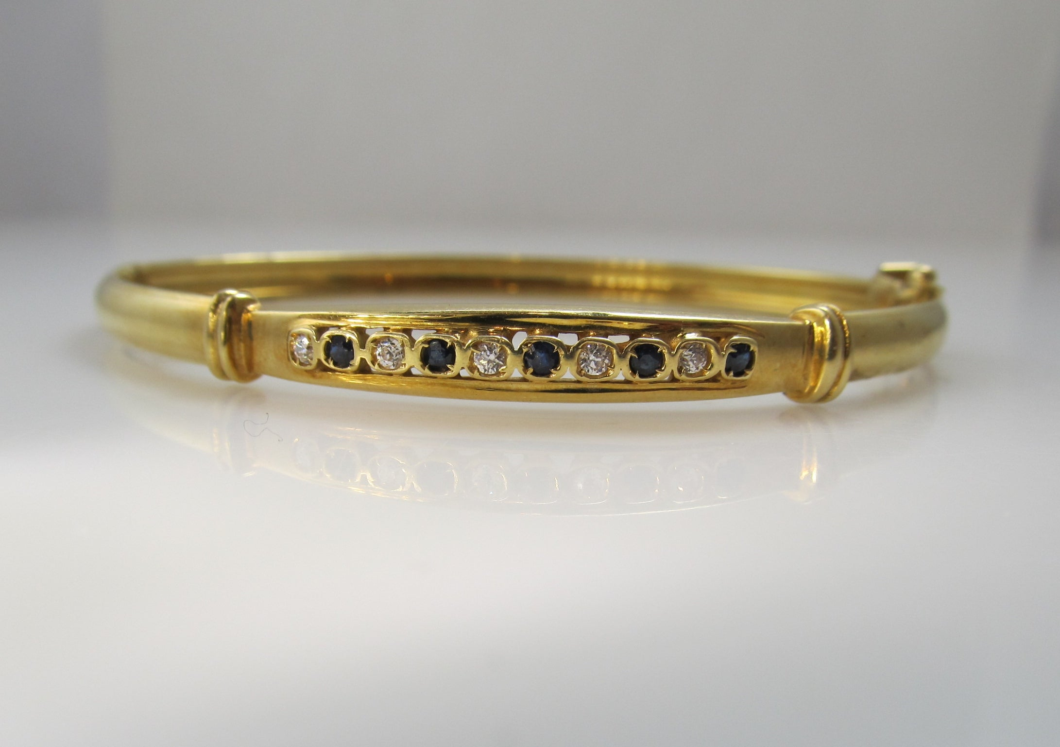 18k yellow gold bangle bracelet with sapphires and diamonds