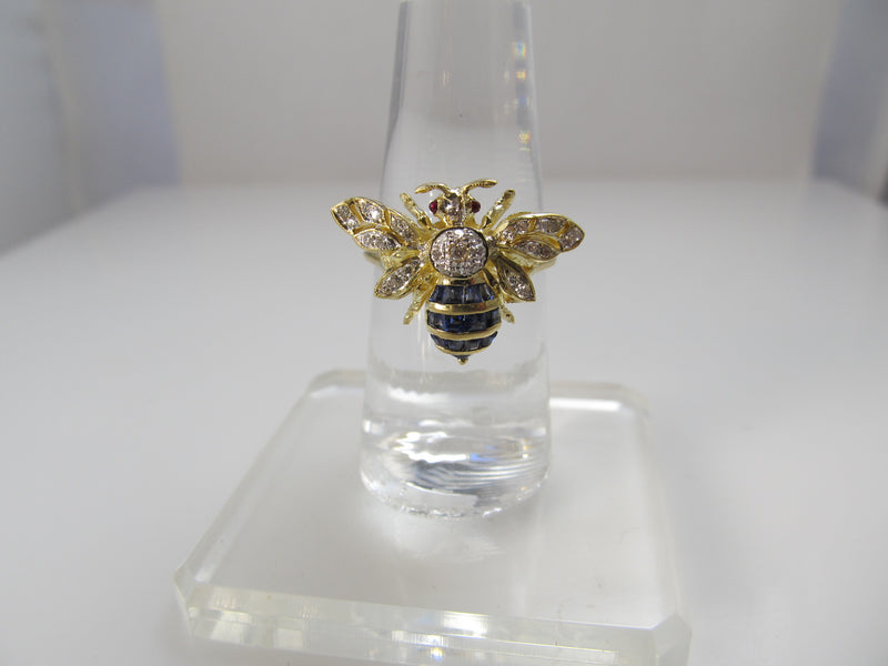 18k gold bee ring with sapphires, diamonds and rubies