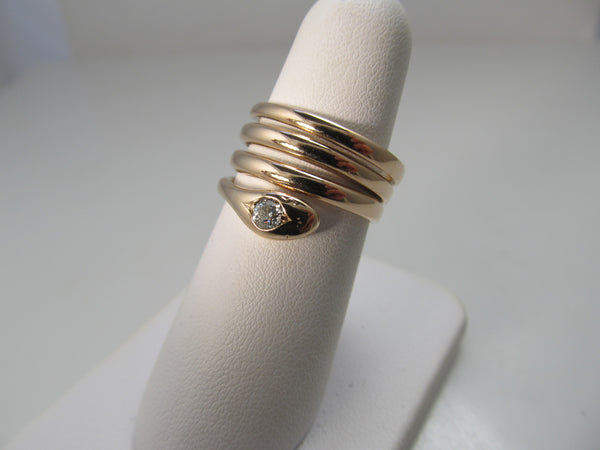 Antique coiled rose gold snake ring with a diamond