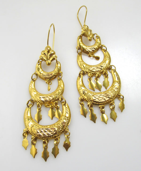 Long bright 18k yellow gold dangle earrings