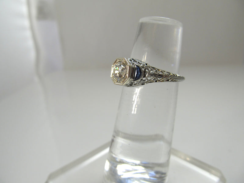 Dated 1928, 18k white gold filigree sapphire diamond ring