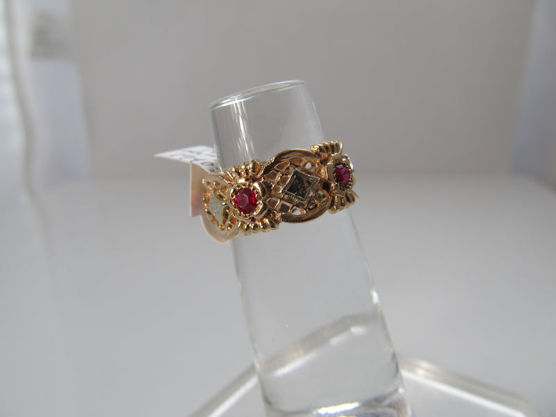 Vintage retro 14k rose gold ruby eternity band