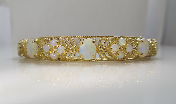 Estate 14k yellow gold 5ct opal bangle bracelet